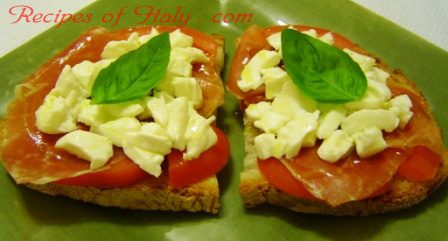 Bruschetta with Prosciutto, Mozzarella and Tomato Photo